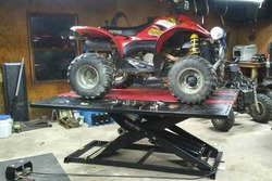 Polaris Scrambler 4x4 500 on the Elevator 1800 Lift Table photo from York County Power Sports and Eq