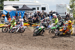 Kawasaki rider Brett Metcalfe #123, Suzuki rider Mike Alessi #2, and KTM rider Cole Thompson #148
