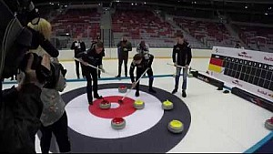 Daniil Kvyat plays curling at Sochi