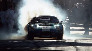 ​Shelby Cobra Daytona Coupe at full tilt up Goodwood's hill